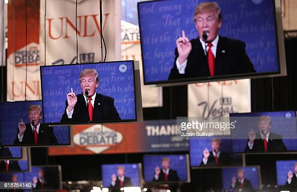 Republican presidential nominee Donald Trump appears on television screens in the media center during the third presidential debate the Thomas Mack...