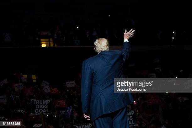 Republican presidential nominee Donald Trump arrives at a campaign rally on October 10 2016 in WilkesBarre Pennsylvania Trump continues his campaign...