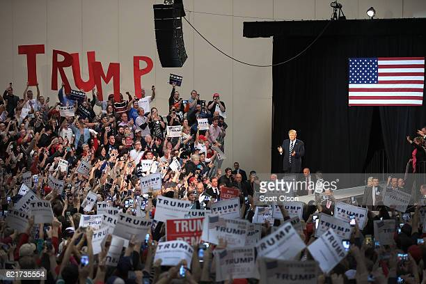 Republican presidential nominee Donald Trump arrives at a campaign rally on November 8 2016 in Grand Rapids Michigan With less than 24 hours until...