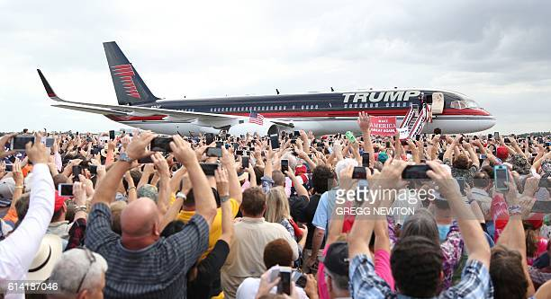Republican presidential nominee Donald Trump arrives for a campaign event at Lakeland Linder Regional Airport in Lakeland, Florida on October 12,...