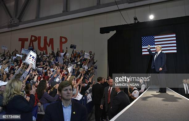 Republican presidential nominee Donald Trump arrives on stage for his final rally of the 2016 presidential campaign at Devos Place in Grand Rapids...
