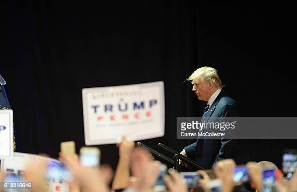 Republican presidential nominee Donald Trump arrives to speak at a rally at the Raddison Hotel on October 28 2016 in Manchester New Hampshire Trump...