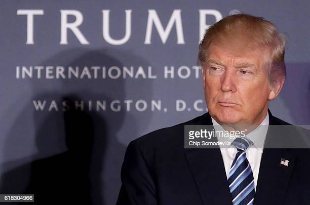 Republican presidential nominee Donald Trump attends the grand opening ceremony at the new Trump International Hotel October 26 2016 in Washington DC...