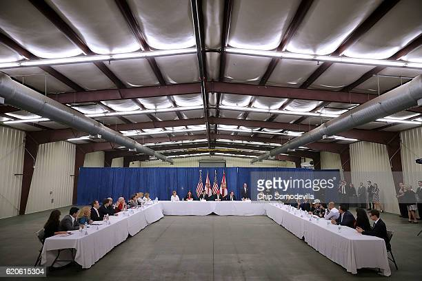 Republican presidential nominee Donald Trump chairs a meeting with a group of small business owerns before a campaign rally the Orlando Amphitheater...