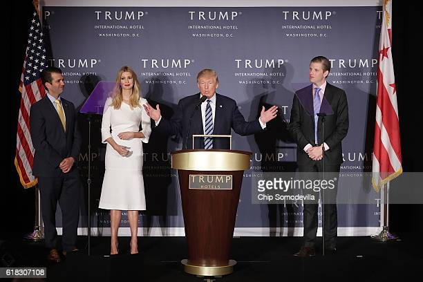 Republican presidential nominee Donald Trump delivers remarks with his children Donald Trump Jr Ivanka Trump and Eric Trump during the grand opening...