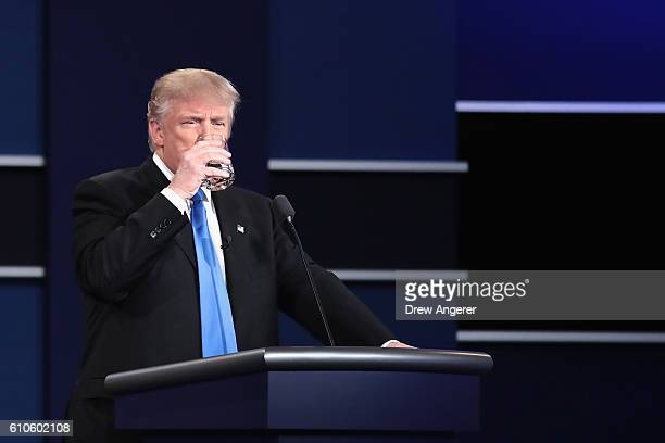 Republican presidential nominee Donald Trump drinks water during the Presidential Debate at Hofstra University on September 26 2016 in Hempstead New...