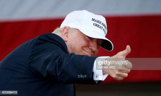Republican presidential nominee Donald Trump gestures as he addresses supporters at a rally in Miami, Florida on November 2, 2016. Hillary Clinton...