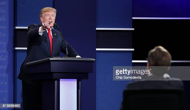 Republican presidential nominee Donald Trump gestures as he speaks during the third US presidential debate at the Thomas Mack Center on October 19...