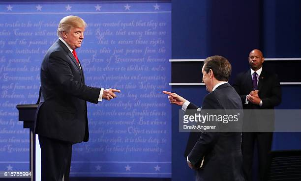 Republican presidential nominee Donald Trump gestures to Fox News anchor and moderator Chris Wallace after the third US presidential debate at the...