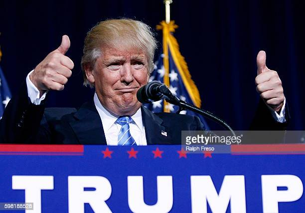 Republican presidential nominee Donald Trump gives a thumbs up the the crowd during a campaign rally on August 31 2016 in Phoenix Arizona Trump...