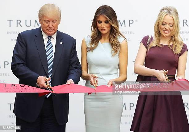 Republican presidential nominee Donald Trump his wife Melania Trump and daughter Tiffany Trump cut the ribbon at the new Trump International Hotel...