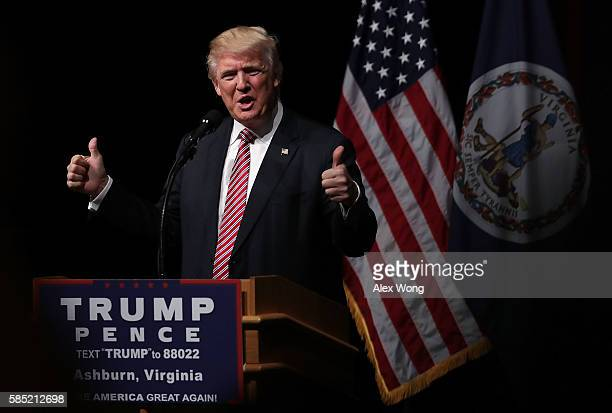 Republican presidential nominee Donald Trump holds two thumbs up during a campaign event at Briar Woods High School August 2, 2016 in Ashburn,...