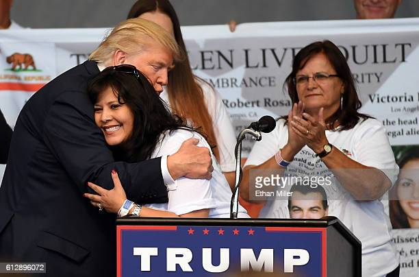 Republican presidential nominee Donald Trump hugs Ruth JohnstonMartin after she spoke about her late husband Don Johnston an officer with the El...