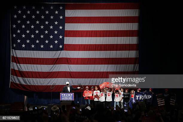 Republican presidential nominee Donald Trump invites a group of children on stage during a campaign rally at the Freedom Hill Amphitheater November 6...