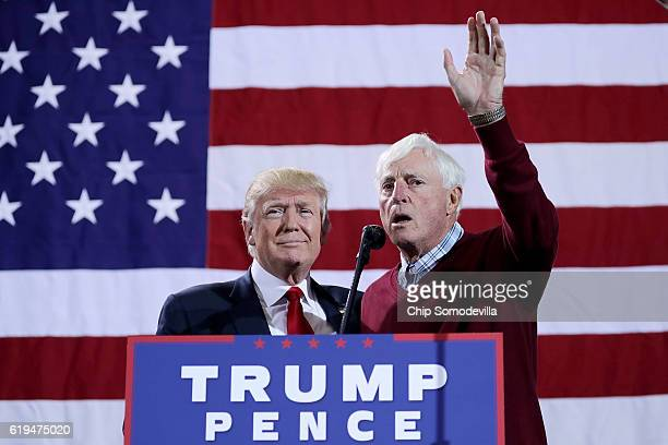 Republican presidential nominee Donald Trump is introduced by former Indiana University basketball coach Bobby Knight during a campaign rally at the...