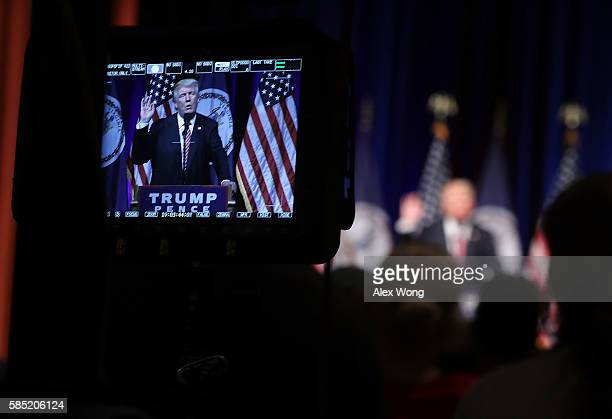 Republican presidential nominee Donald Trump is seen on a monitor as he speaks to voters during a campaign event at Briar Woods High School August 2,...