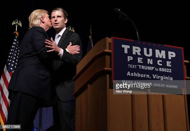 Republican presidential nominee Donald Trump kisses his son Eric Trump during a campaign event at Briar Woods High School August 2, 2016 in Ashburn,...
