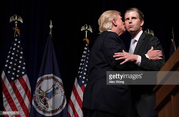 Republican presidential nominee Donald Trump kisses his son Eric Trump during a campaign event at Briar Woods High School August 2 2016 in Ashburn...