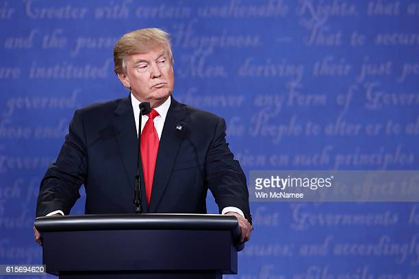 Republican presidential nominee Donald Trump listens as Democratic presidential nominee former Secretary of State Hillary Clinton speaks during the...