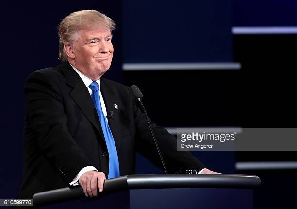 Republican presidential nominee Donald Trump looks on during the Presidential Debate at Hofstra University on September 26 2016 in Hempstead New York...
