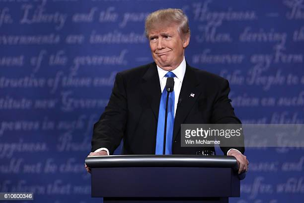 Republican presidential nominee Donald Trump makes a face during the Presidential Debate at Hofstra University on September 26, 2016 in Hempstead,...