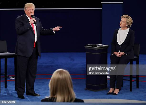 Republican presidential nominee Donald Trump points at Democratic presidential nominee former Secretary of State Hillary Clinton during the town hall...