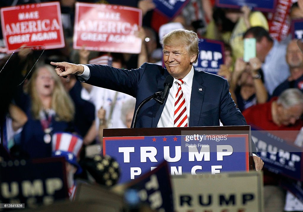 Republican presidential nominee Donald Trump points out to the crowd of supporters as he arrives at a campaign rally on October 4, 2016 in Prescott Valley, Arizona.