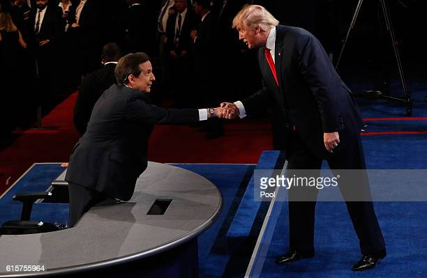 Republican presidential nominee Donald Trump shakes hands with Fox News anchor and moderator Chris Wallace after the third U.S. Presidential debate...
