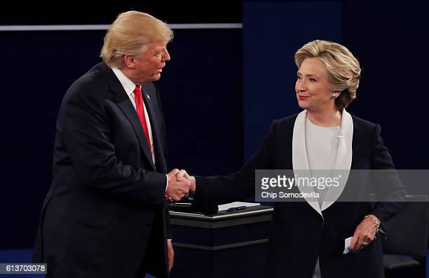 Republican presidential nominee Donald Trump shakes hands with Democratic presidential nominee former Secretary of State Hillary Clinton during the...