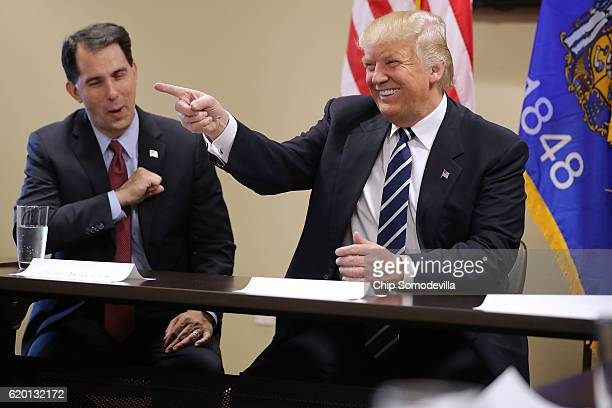 Republican presidential nominee Donald Trump sits down with Wisconsin Governor Scott Walker and a group of invited small business owners for a round...