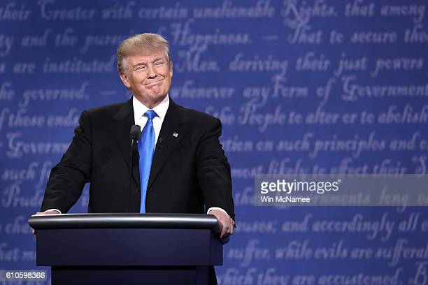 Republican presidential nominee Donald Trump smiles during the Presidential Debate at Hofstra University on September 26 2016 in Hempstead New York...