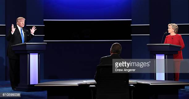 Republican presidential nominee Donald Trump speaks as Democratic presidential nominee Hillary Clinton and Moderator Lester Holt listens during the...
