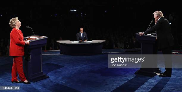 Republican presidential nominee Donald Trump speaks as Democratic presidential nominee Hillary Clinton and Moderator Lester Holt listen during the...