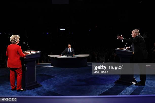 Republican presidential nominee Donald Trump speaks as Democratic presidential nominee Hillary Clinton listens during the Presidential Debate at...