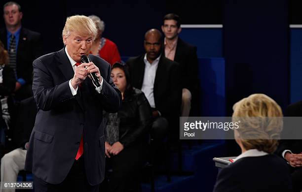 Republican presidential nominee Donald Trump speaks as Democratic presidential nominee former Secretary of State Hillary Clinton listens during the...