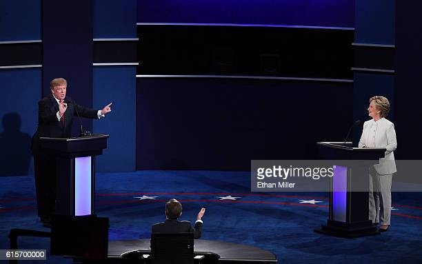 Republican presidential nominee Donald Trump speaks as Democratic presidential nominee former Secretary of State Hillary Clinton looks on during the...