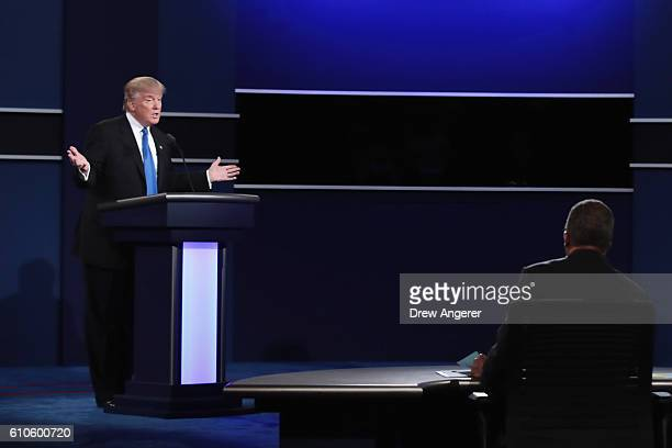 Republican presidential nominee Donald Trump speaks as Moderator Lester Holt looks on during the Presidential Debate at Hofstra University on...