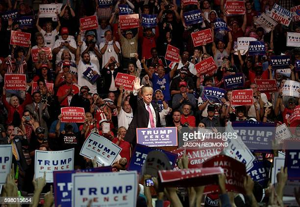 TOPSHOT Republican presidential nominee Donald Trump speaks at a rally at Xfinity Arena in Everett Washington on August 30 2016 / AFP / Jason Redmond