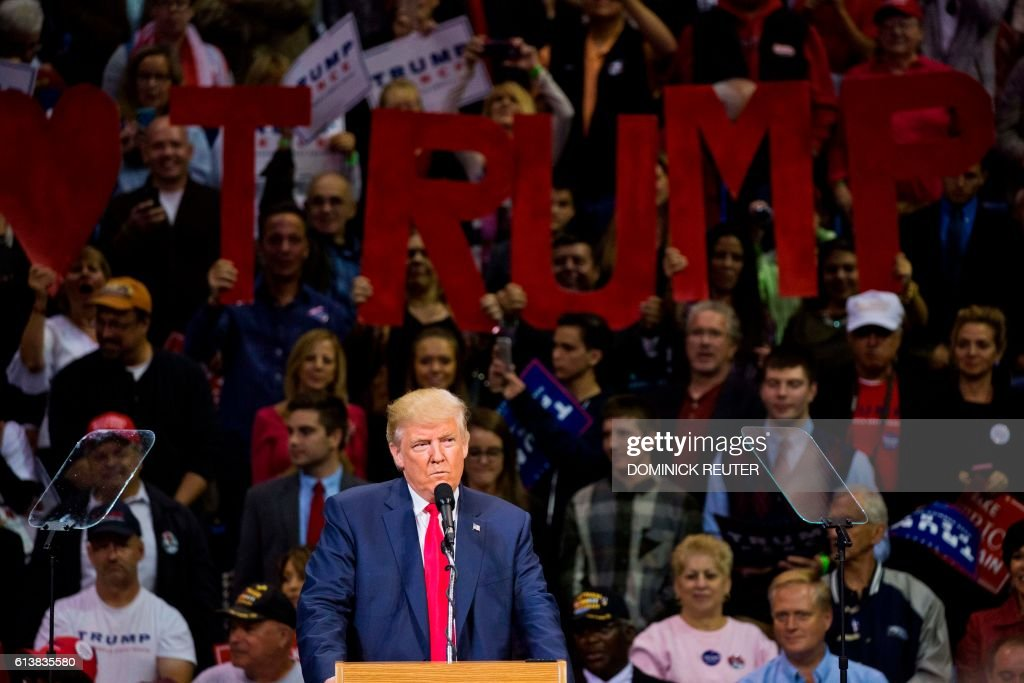 TOPSHOT - Republican presidential nominee Donald Trump speaks during a rally at Mohegan Sun Arena in Wilkes-Barre, Pennsylvania on October 10, 2016. / AFP / DOMINICK