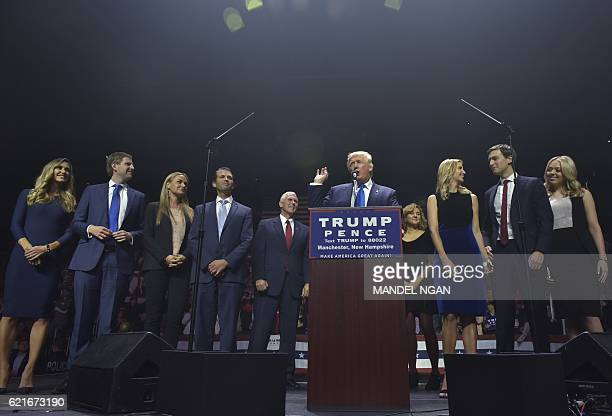 Republican presidential nominee Donald Trump speaks during a rally at the SNHU Arena in Manchester, New Hampshire on November 7, 2016. From left:...