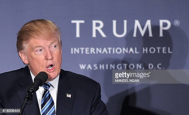 Republican presidential nominee Donald Trump speaks during the grand opening of the Trump International Hotel in Washington DC on October 26 2016 /...