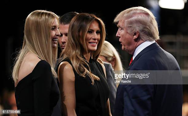 Republican presidential nominee Donald Trump speaks with his wife Melania Trump and his daughter Ivanka Trump after the third U.S. Presidential...