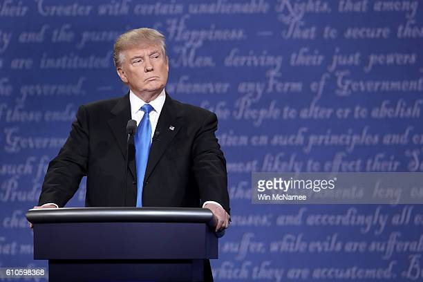 Republican presidential nominee Donald Trump stands at his podium during the Presidential Debate at Hofstra University on September 26 2016 in...