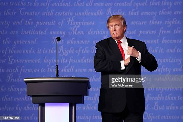 Republican presidential nominee Donald Trump stands on stage after the third US presidential debate at the Thomas Mack Center on October 19 2016 in...