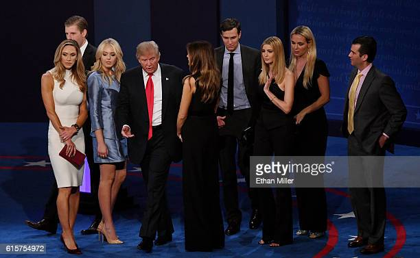 Republican presidential nominee Donald Trump stands onstage with businessman Jared Kushner and members of his family including Eric Trump Lara...