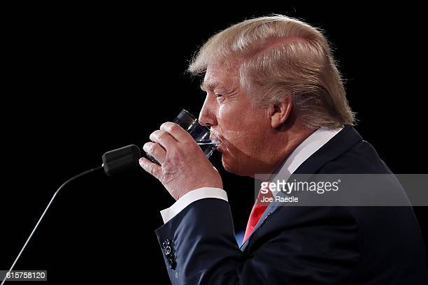Republican presidential nominee Donald Trump takes a drink of water during the third US presidential debate at the Thomas Mack Center on October 19...