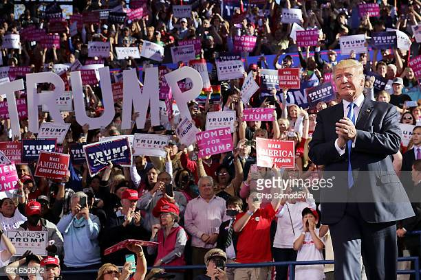 Republican presidential nominee Donald Trump takes the stage during a campaign rally at the JS Dorton Arena November 7 2016 in Raleigh North Carolina...