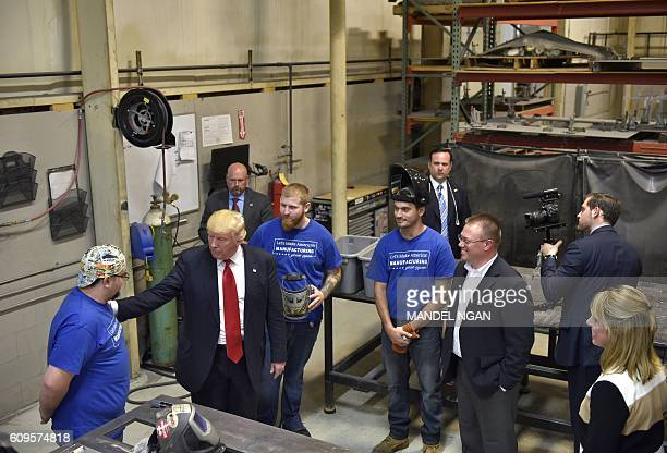 US Republican presidential nominee Donald Trump tours Staub Manufacturing Solutions in Dayton Ohio on September 21 2016 / AFP / MANDEL NGAN