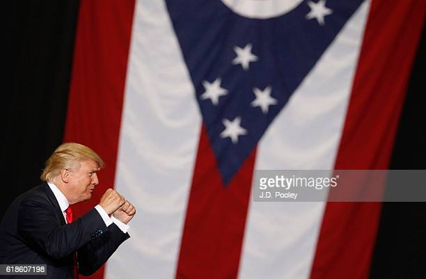 Republican presidential nominee Donald Trump walks on stage during a campaign event at the SeaGate Convention Centre on October 27, 2016 in Toledo,...