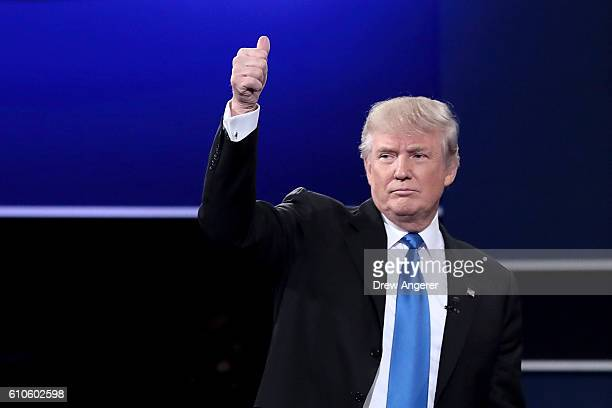 Republican presidential nominee Donald Trump waves after the Presidential Debate with Democratic presidential nominee Hillary Clinton at Hofstra...